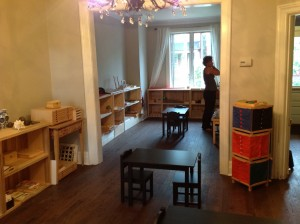 The Orchard Montessori School began as an co-op school called Ma Maison. Melody Incledon, the Cada Directress, inspects the prepared environment.