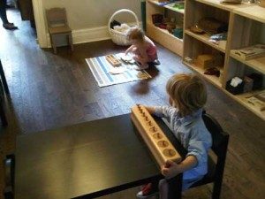 The Orchard Montessori School began as an co-op school called Ma Maison. Several students are concentrating on their work at the newly opened Ma Maison school.